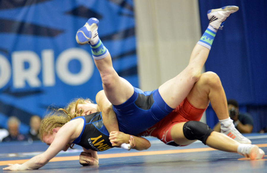 Reigning+world+champion+Helen+Maroulis+of+Huntington+Beach%2C+Calif.%2C+takes+down+Sgt.+Whitney+Conder+en+route+to+a+10-0%2C+11-0+victory+in+the+women%27s+freestyle+53-kilogram+best-of-three+finals+of+the+2016+U.S.+Olympic+Wrestling+Team+Trials+on+April+10+at+Carver-Hawkeye+Arena+on+the+University+of+Iowa+campus+in+Iowa+City.+%28U.S.+Army+IMCOM+photo+by+Tim+Hipps%29+%23RoadToRIo+%23WCAP+%23ArmyTeam+%23USAWrestling