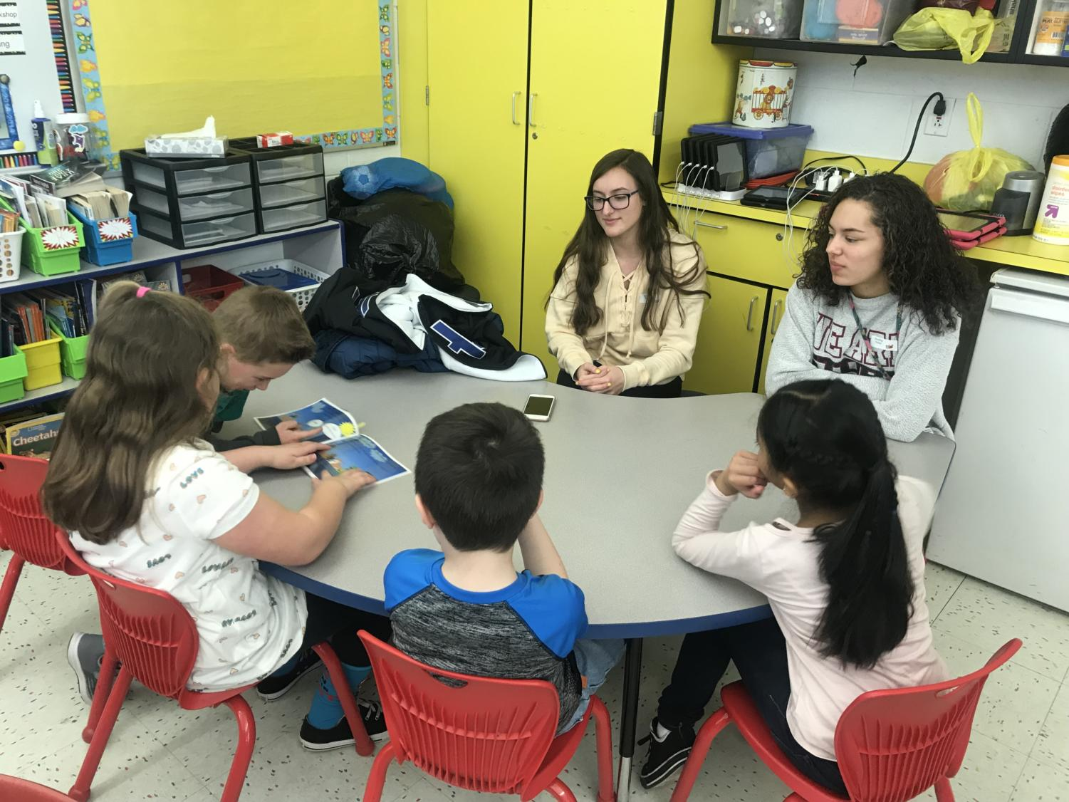 Student in Ms. Rogalcheck's Honors English 3 wrote their own children's stories to read to ECEC students on Tuesday, February 26