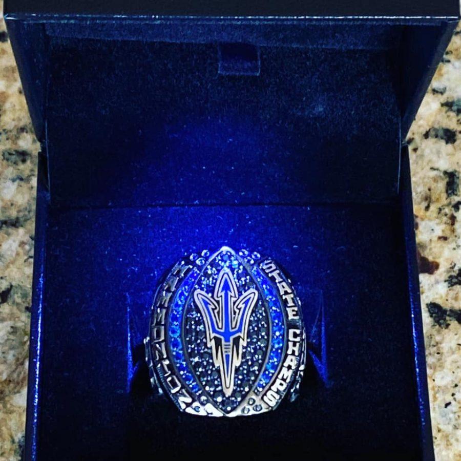 Football team receives championship rings