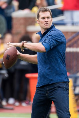 Tom Brady plays catch with Head Coach Jim Harbaugh  before Michigan