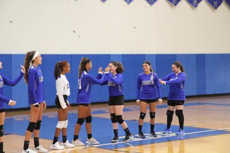 Girls volleyball players discuss season postponement